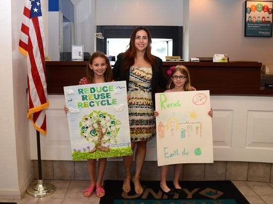 An Earth Day poster contest, sponsored by Unity Bank,for Fanwood's annual Earth Day celebration awarded $50 to each poster-designer winner. Left to right: Taylor Klein, Park Middle School, Ana Diaz, Relationship Manager, Unity Bank; and Emily Juckes, Brunner Elementary School