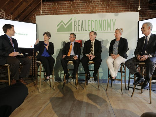 "The Des Moines Register, Wells Fargo and USA TODAY presented a forum on the ""real economy"" Friday at Salisbury House in Des Moines. From left are Register reporter and moderator Joel Aschbrenner, U.S. Sen. Joni Ernst, Greater Des Moines Convention and Visitors Bureau CEO Greg Edwards, Iowa State University agricultural economics professor Dermot Hayes, Creme Cupcake owner Christina Moffatt, and Knapp Properties President Gerry Neugent."
