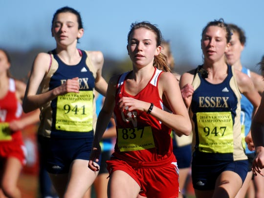 Champlain Valley's Sophia Gorman is flanked by Essex's Emma Farrington, left, and Annemarie Martell during the Division I high school girls cross-country state meet race.