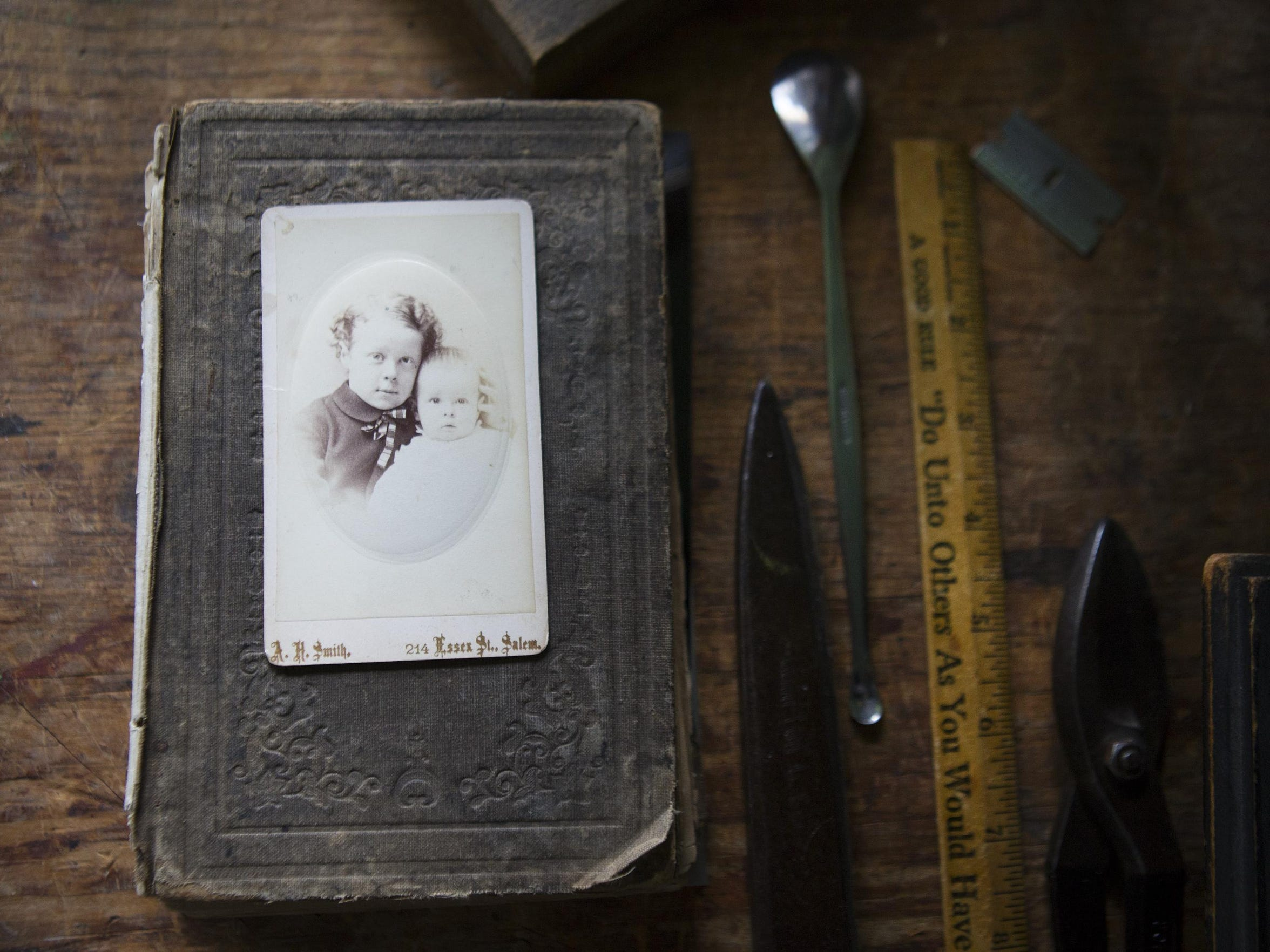 A 19th-century carte de visite sits among tools in