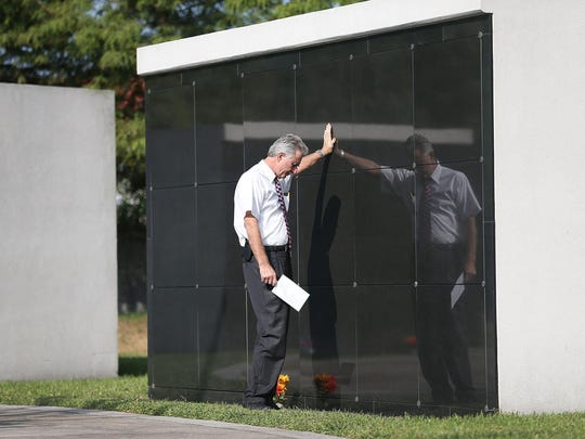 C. Gary Wainwright pays his respects at the New Orleans Katrina Memorial where nearly 100 unclaimed or unidentified victims of Hurricane Katrina are interred as he attends an event marking the 10th anniversary of Hurricane Katrina on Saturday, Aug. 29, 2015 in New Orleans.