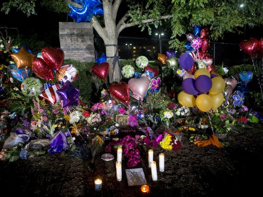 A makeshift memorial for WDBJ-TV reporter Alison Parker and cameraman Adam Ward gathers by a tree near the station Thursday, Aug. 27, 2015, in Roanoke, Va.