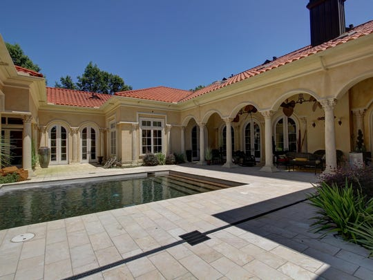 A Mediterranean style courtyard and pool invite outdoor entertaining.