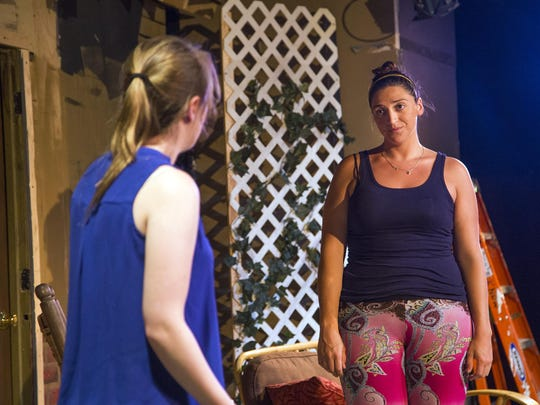 Actress Caitlin McNichol, right, rehearses a scene