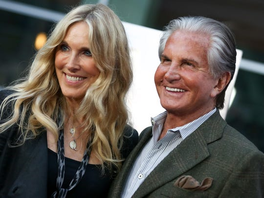 """Alana Stewart, left, and George Hamilton seen here at the LA Premiere of """"Being Evel"""" on Aug. 19, vacationed in Palm Springs in the most recent episode of """"Stewarts & Hamiltons"""" on E!."""