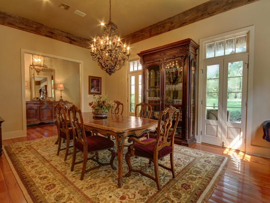 The large, formal dining room looks out on to 3.20 acres of beautiful property.
