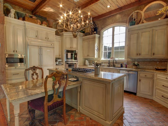 The gourmet kitchen is French Country with a casual, yet elegant ambiance.