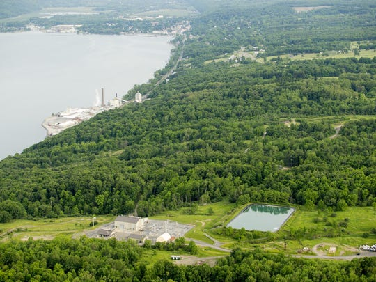 In this view facing south, Crestwood's Seneca Lake Compressor Station, foreground left, and brine pond, foreground right, sit northwest of the U.S. Salt factory, left, on the western shore of Seneca Lake, in the Town of Reading, north of the village of Watkins Glen, top left.