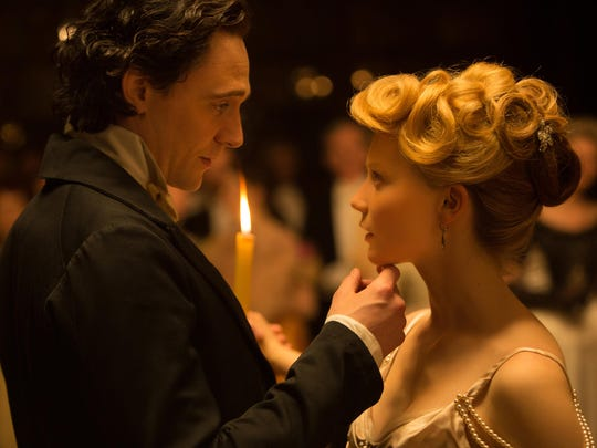 "Tom Hiddleston, left, and Mia Wasikowska appear in a scene from ""Crimson Peak."""