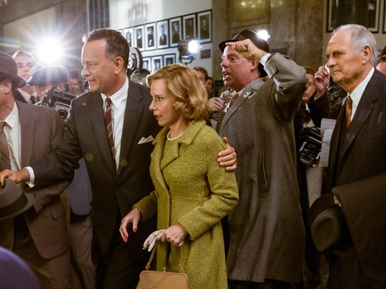 """Tom Hanks, second left, Amy Ryan, center, and Alan Alda, right, appear in a scene from """"Bridge of Spies."""""""