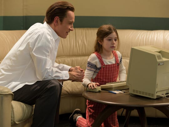 """Michael Fassbender, left, as Steve Jobs and Makenzie Moss as a young Lisa Jobs, appear in a scene from the film """"Steve Jobs."""""""