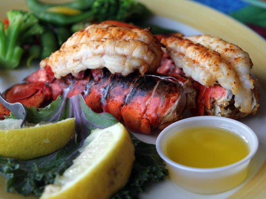 The twin 4 oz Canadian lobster dish is served with vegetables and a drum butter lemon sauce. The lobster can be enjoyed broiled or deep fried, depending on preference
