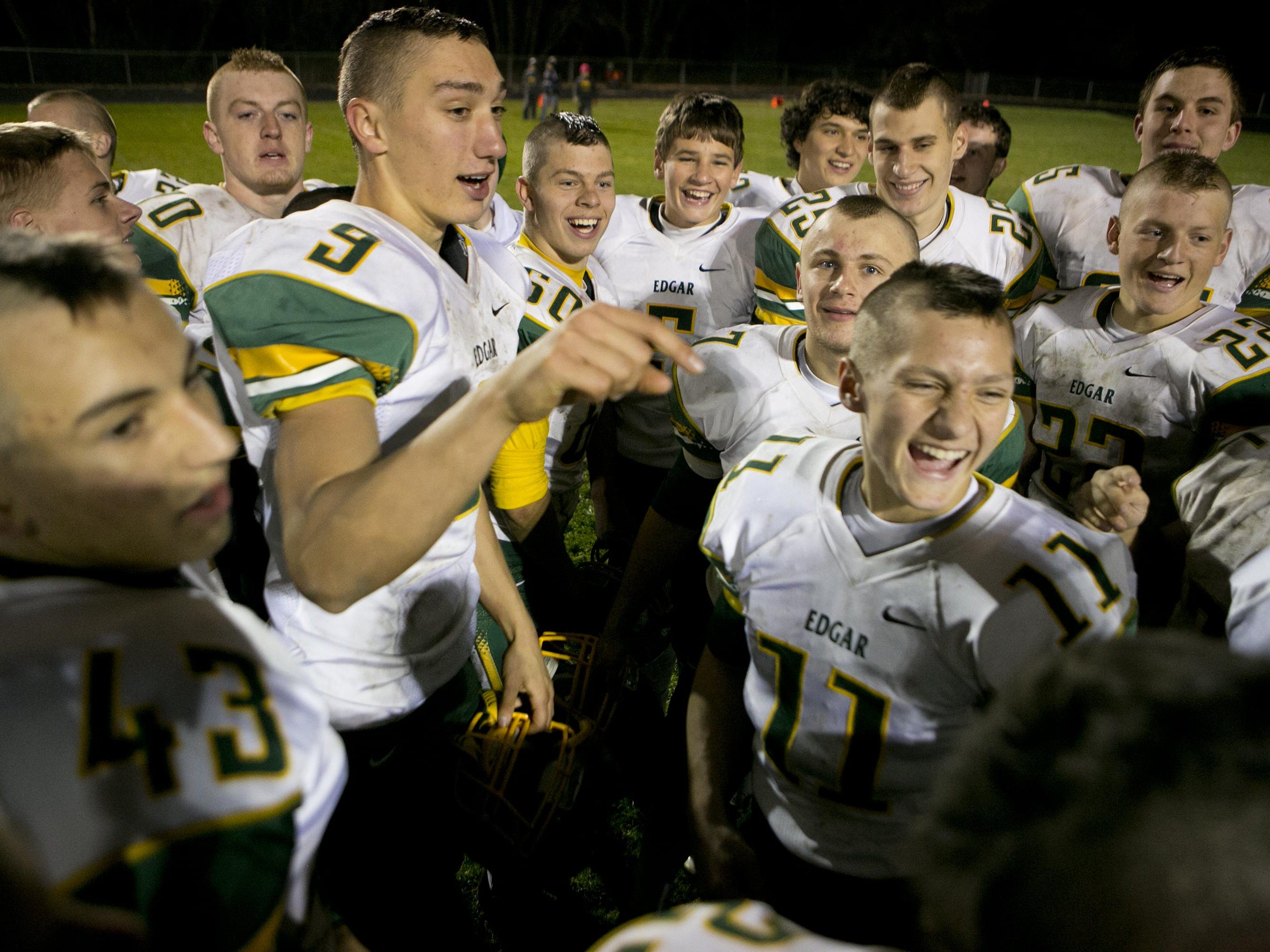 Edgar celebrates its 36-6 win against Marathon after the Level 2 Division 6 football playoff game at Marathon High School, Friday.