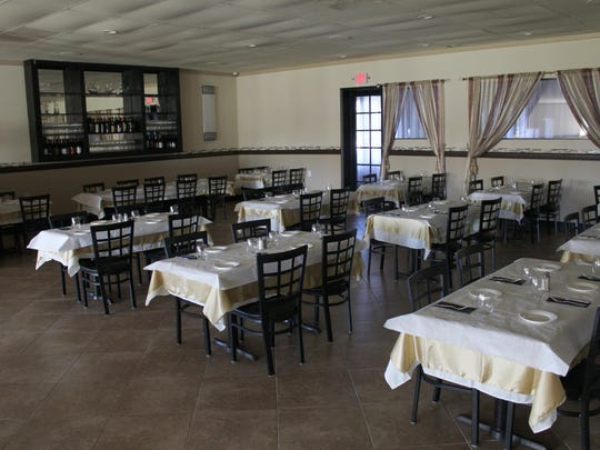 Part of the dining room shows the new look for the restaurant over the former eatery.