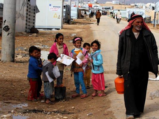 IMG_PNI_syrian_refugee_f_1_1_54A2V0BH.jpg_20150301.jpg