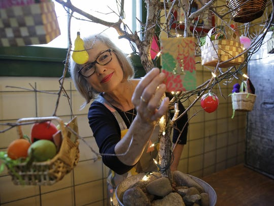 """The Giving Tree, one of Carrie Brown's favorites, turns the tables on the typical advent calendar. Ornaments include envelopes holding age-appropriate """"good deed"""" slips. Children get to open an envelope every day in the countdown to Christmas, but instead of getting chocolate they have a chance to exercise their generosity."""