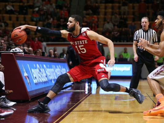 North Carolina State's Cody Martin, left, loses the ball out of bounds in overtime  of an NCAA college basketball game against  Virginia Tech in Blacksburg Va. Saturday, Jan. 2, 2016. Virginia Tech won the game 73-68. (Matt Gentry /The Roanoke Times via AP) LOCAL TELEVISION OUT; SALEM TIMES REGISTER OUT; FINCASTLE HERALD OUT;  CHRISTIANBURG NEWS MESSENGER OUT; RADFORD NEWS JOURNAL OUT; ROANOKE STAR SENTINEL OUT; MANDATORY CREDIT