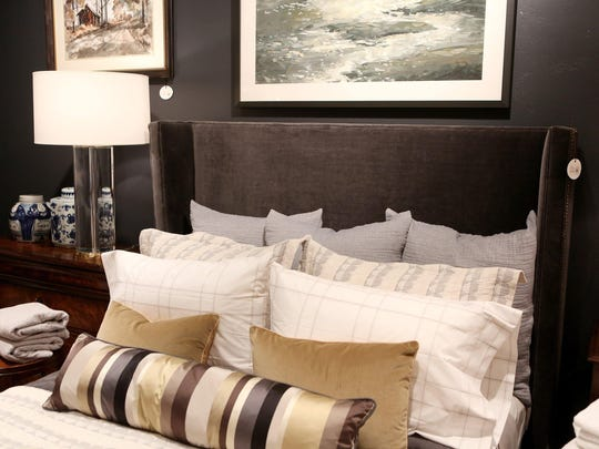 Gray and caramel are big colors for the bedroom, as is mixing and matching patters.