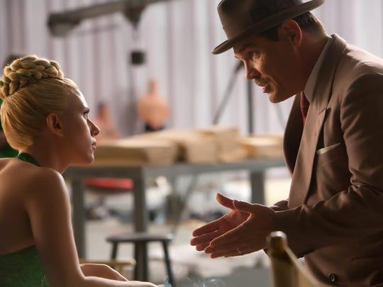 "Scarlett Johansson, left, and Josh Brolin appear in a scene from ""Hail, Caesar!"""