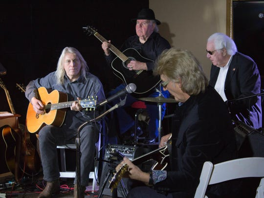 icky Ray, W.S. Holland and Stan Perkins play old blues and rock 'n' roll favorites during a concert at the Carnegie Center in 2014.