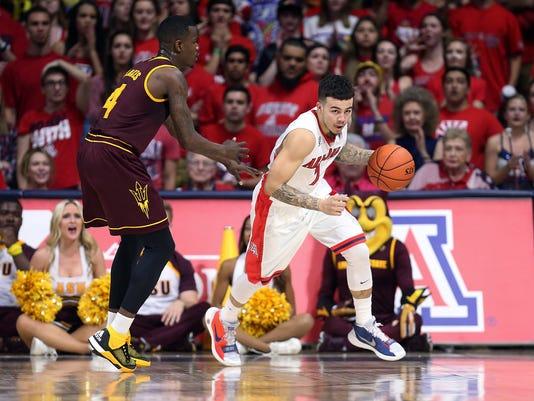 Arizona guard Gabe York (1) runs past Arizona State guard Gerry Blakes (4) during the first half of an NCAA college basketball game Wednesday, Feb. 17, 2016, in Tucson, Ariz. (AP Photo/Chris Coduto)