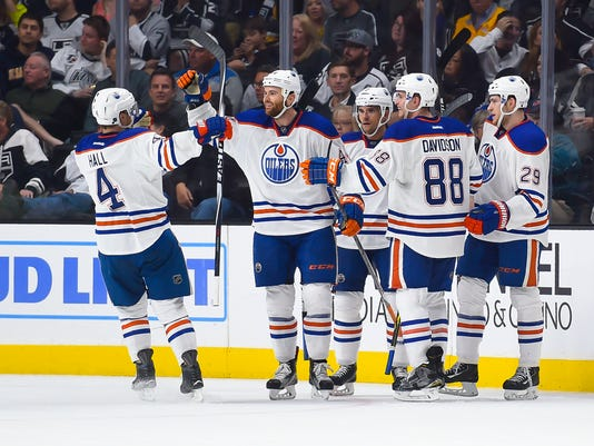 Edmonton Oilers right wing Zack Kassian, center, celebrates his goal with teammates left wing Taylor Hall (4), defenseman Brandon Davidson (88), center Leon Draisaitl (29), of Germany, and defenseman Andrej Sekera, back center right, of Slovakia, during the second period of an NHL hockey game against the Los Angeles Kings on Thursday, Feb. 25, 2016, in Los Angeles. (AP Photo/Gus Ruelas)