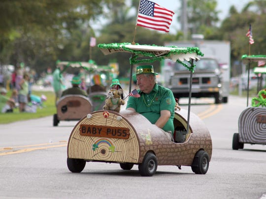 Araba Shriners weave down the road during the previous parade down Bald Eagle Drive.