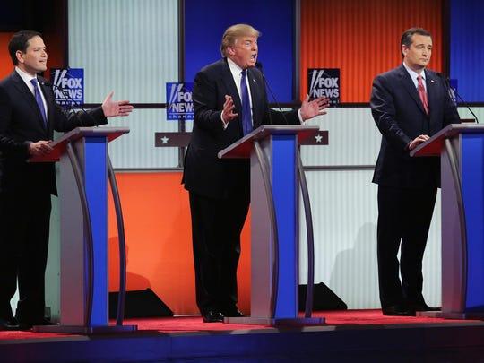 Republican presidential candidates U.S. Sen. Marco Rubio, R-Fla., businessman Donald Trump and U.S. Sen. Ted Cruz, R-Texas, participate in a debate sponsored by Fox News at the Fox Theatre on March 3, 2016 in Detroit.