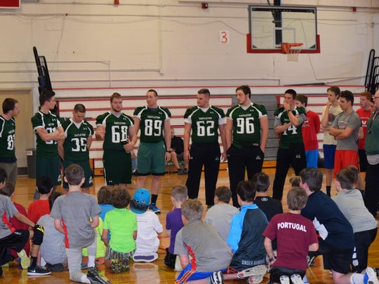 Members of Castleton University football team help with the CVU Flag Football program.