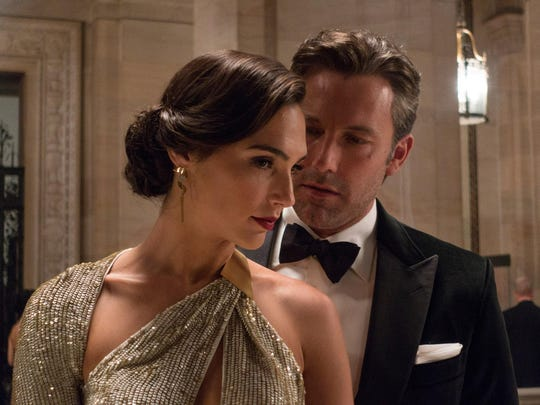 """This image released by Warner Bros. Pictures shows Gal Gadot, left, and Ben Affleck in a scene from, """"Batman v Superman: Dawn of Justice."""" (Clay Enos/Warner Bros. Pictures via AP)"""