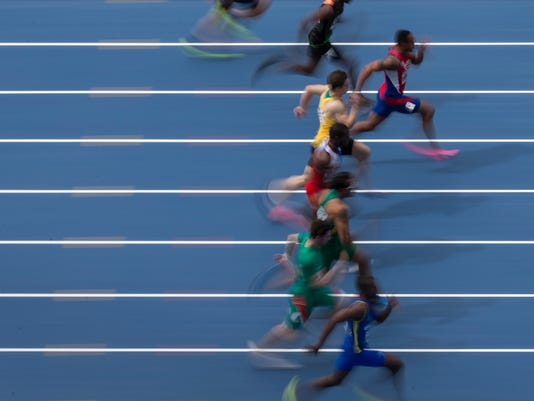 Men compete in the 100m semifinal 1 during the Athletics test event at the Rio Olympic Stadium in Rio de Janeiro, Brazil, Saturday, May 14, 2016. The track and field test event is the last of more than 40 tests events for the Rio de Janeiro Olympics with the games opening in less than three months. The three-day test event ends Monday at Olympic Stadium in the northern neighborhood known as Engenho de Dentro. (AP Photo/Felipe Dana)