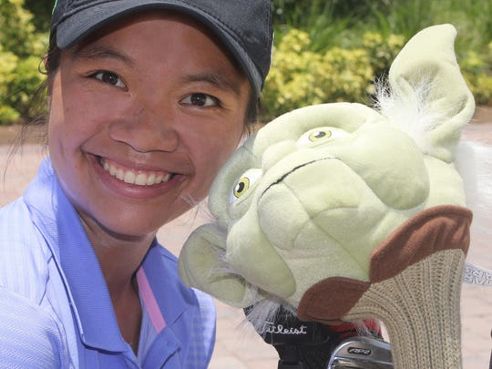 FGCU golfer, golf adminstration student and Hammock Bay cart attendant Myka Jong poses with an unusual driver cover.