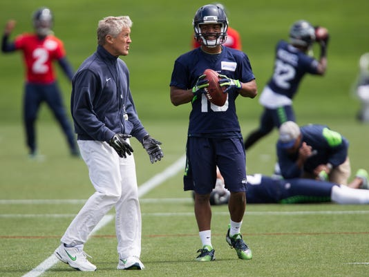 Seahawks head coach Pete Carroll meets with wide receiver Tyler Lockett during NFL football practice, Tuesday, June 14, 2016 at Virginia Mason Athletic Center in Renton, Wash. (Grant Hindsley/seattlepi.com via AP) MAGS OUT; NO SALES; SEATTLE TIMES OUT; TV OUT; MANDATORY CREDIT