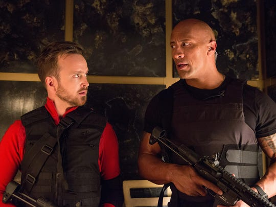 "Aaron Paul, left, and Dwayne Johnson are see in ""Central Intelligence."""