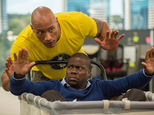 "Kevin Hart, bottom, and Dwayne Johnson in a scene from, ""Central Intelligence."""
