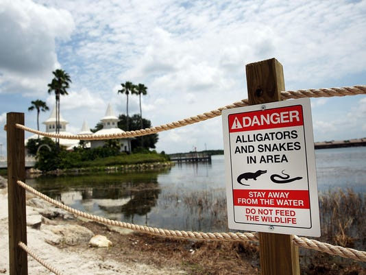***BESTPIX*** Disney Installs Alligator Warning Signs In Aftermath Of Toddler Death At One Of Its Resorts