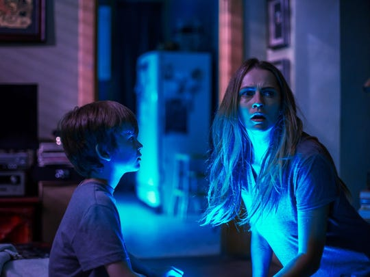 "Gabriel Bateman and Teresa Palmer in ""Lights Out."""