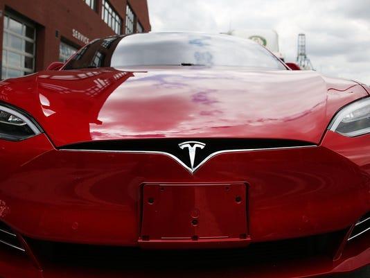 FILE: Tesla To Buy SolarCity For $2.6 Billion