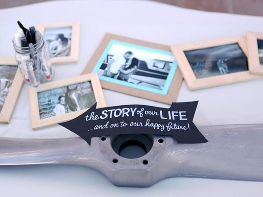 In this Aug. 31, 2014 photo provided by Austin Busy Brides, a propeller used by a couple who are pilots as a wedding guest book displays personal photos at Winslow-Lindbergh Airport, Winslow, Ariz.