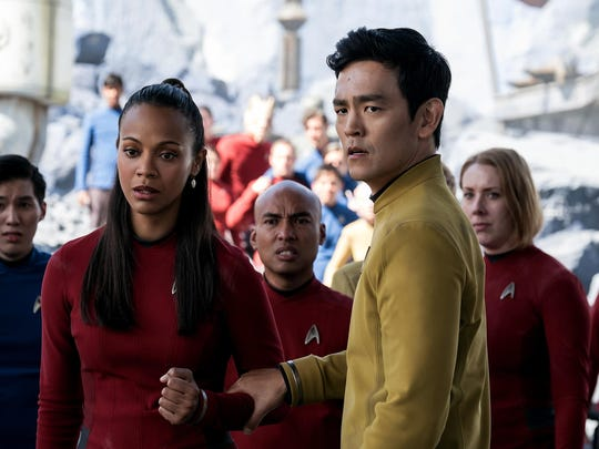 """In this image released by Paramount Pictures, Zoe Saldana, left, as Uhura and John Cho as Sulu appear in a scene from, """"Star Trek Beyond."""" (Kimberley French/Paramount Pictures via AP)"""