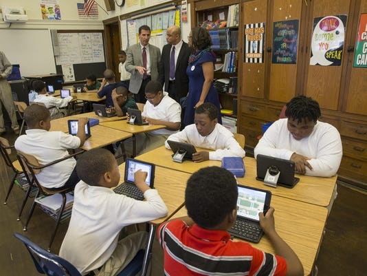 Michigan State Senator Morris W. Hood, III, tours Noble Elementary Middle School in Detroit, Friday, April 22, 2016 with Learning.com Vice President Brian Rose. The education tech company donated 100 iPad keyboards to the school to help students develop c