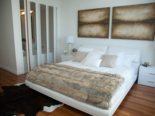 Even just a touch of brown, as seen in this artwork and faux fur throw, can make a room feel more welcoming and luxurious.