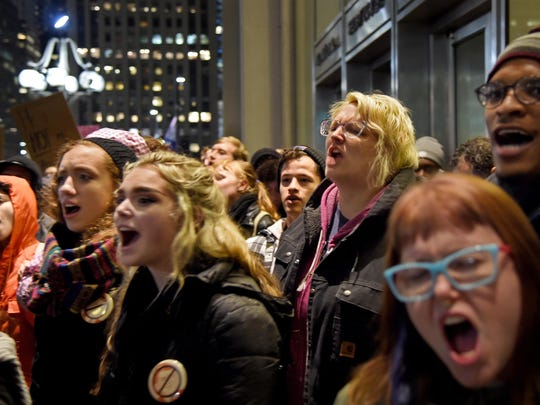 Demonstrators shout during a protest in City Hall's Thomas Paine Plaza, Wednesday, Nov. 9, 2016, in opposition of Donald Trump's presidential election victory. (Tom Gralish/The Philadelphia Inquirer via AP)