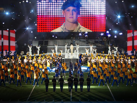 """Billy Lynn (Joe Alwyn), dancers, and Alabama State Marching Hornets in """"Billy Lynn's Long Halftime Walk."""""""