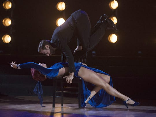"IndyCar driver James Hinchcliffe performs an Argentine tango with professional partner Sharna Burgess on ""Dancing with the Stars."""