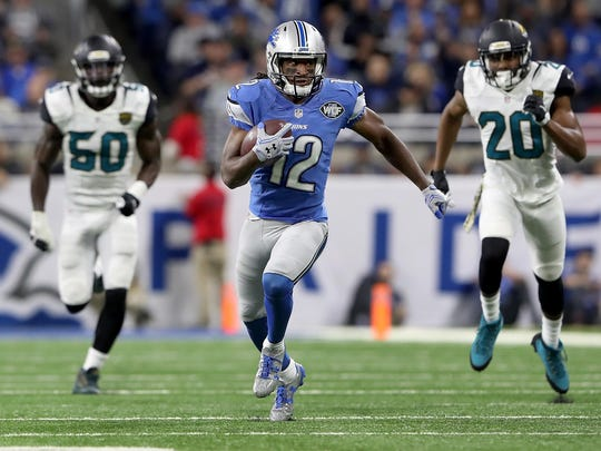 624670106.jpg DETROIT, MI - NOVEMBER 20: Andre Roberts #12 of the Detroit Lions runs for yardage after catching a pass against Telvin Smith #50 of the Jacksonville Jaguars and Jalen Ramsey #20 during fourth quarter action at Ford Field on November 20, 2016 in Detroit, Michigan. (Photo by Leon Halip/Getty Images)
