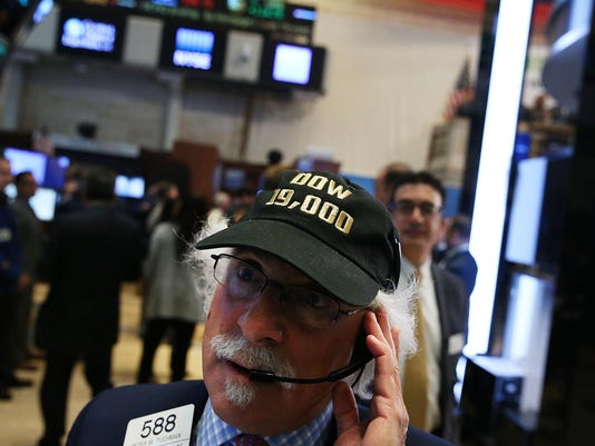 Dow Climbs Over 19,000 For First Time As Stock Rally Continues
