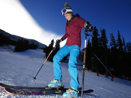 Anna Marie Migl, from Denver, steps into her bindings before a run at Arapahoe Basin Ski Area.