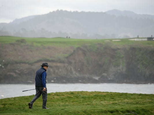 Andy Garcia walks to his ball off the 17th green during the celebrity challenge event of the AT&T Pebble Beach National Pro-Am golf tournament Wednesday, Feb. 8, 2017, in Pebble Beach, Calif. (AP Photo/Eric Risberg)
