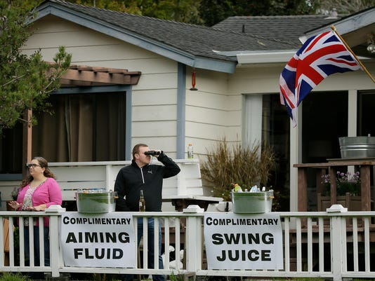 Spectators watch the playing group of Dustin Johnson, Jordan Spieth, Wayne Gretzky and Jake Owen as they hit from the third tee of the Monterey Peninsula Country Club Shore Course during the first round of the AT&T Pebble Beach National Pro-Am golf tournament Thursday, Feb. 9, 2017, in Pebble Beach, Calif. (AP Photo/Eric Risberg)